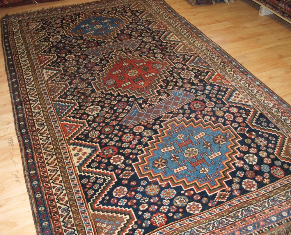 antique luri carpet three medallions field of stars tribal design circa 1900