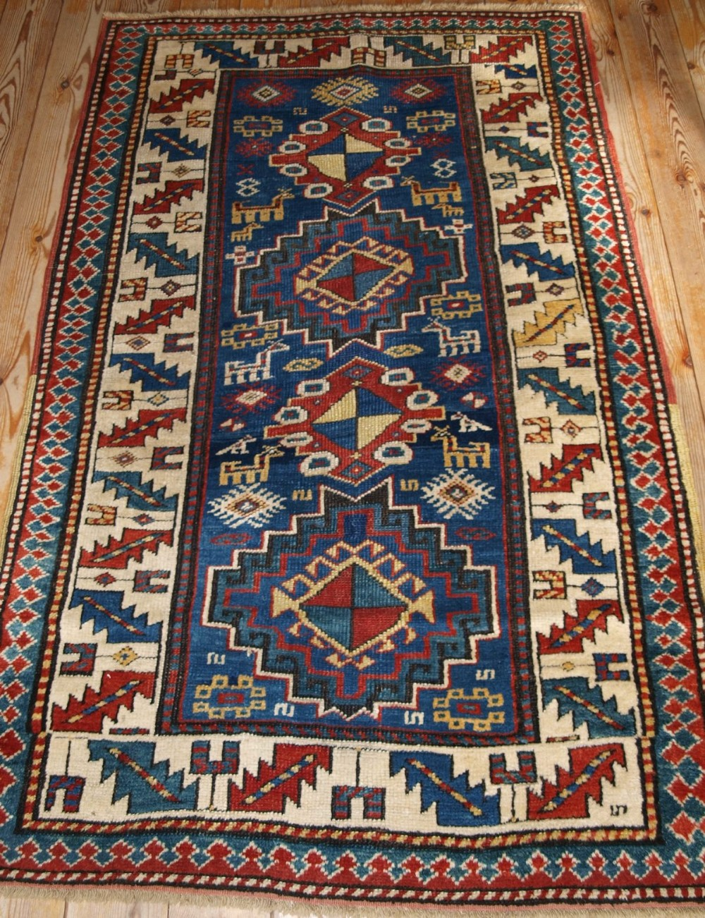 antique caucasian kazak rug bold design with animals late 19th cent