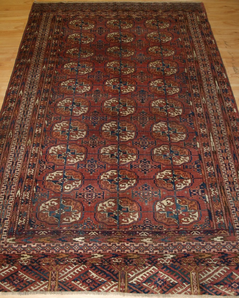 antique tekke turkmen rug well drawn with large guls circa 1900