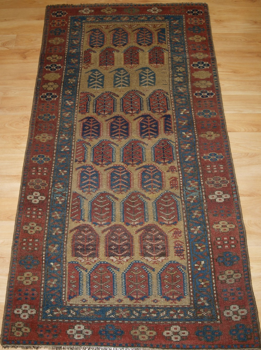antique kurdish rug with large boteh design soft colours circa 1900