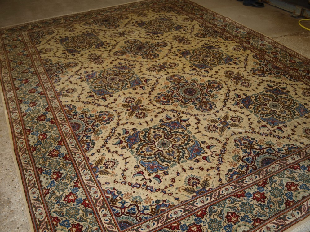 old persian qum carpet ivory ground with traditional design about 60 years old