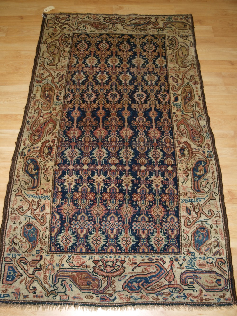 antique kurdish rug with large wild boteh design border soft colours circa 1900