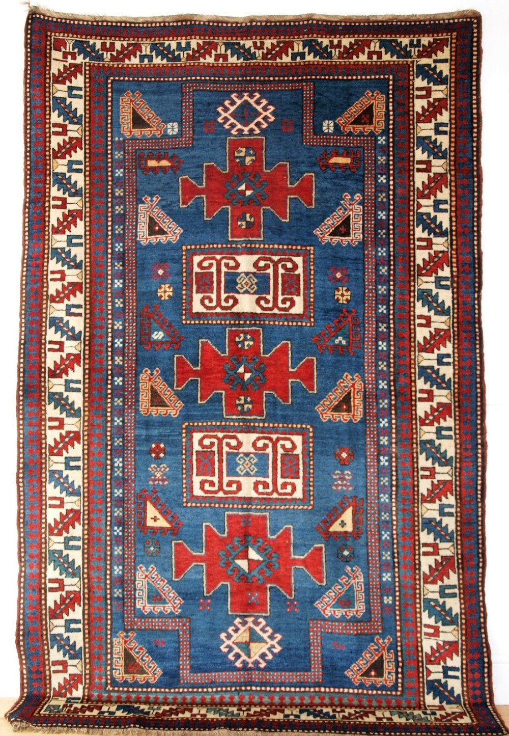 antique caucasian karachop kazak with blue ground outstanding colour circa 1890