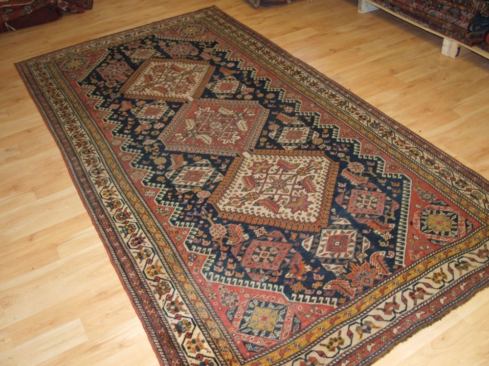 antique persian tribal qashqai rug triple medallion with large scale heratti design circa 1900