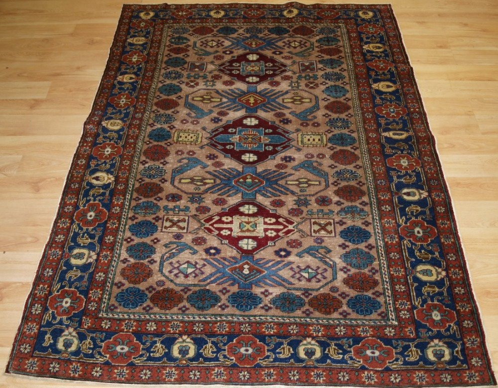 antique turkish kayseri rug with a caucasian kuba region design circa 190020