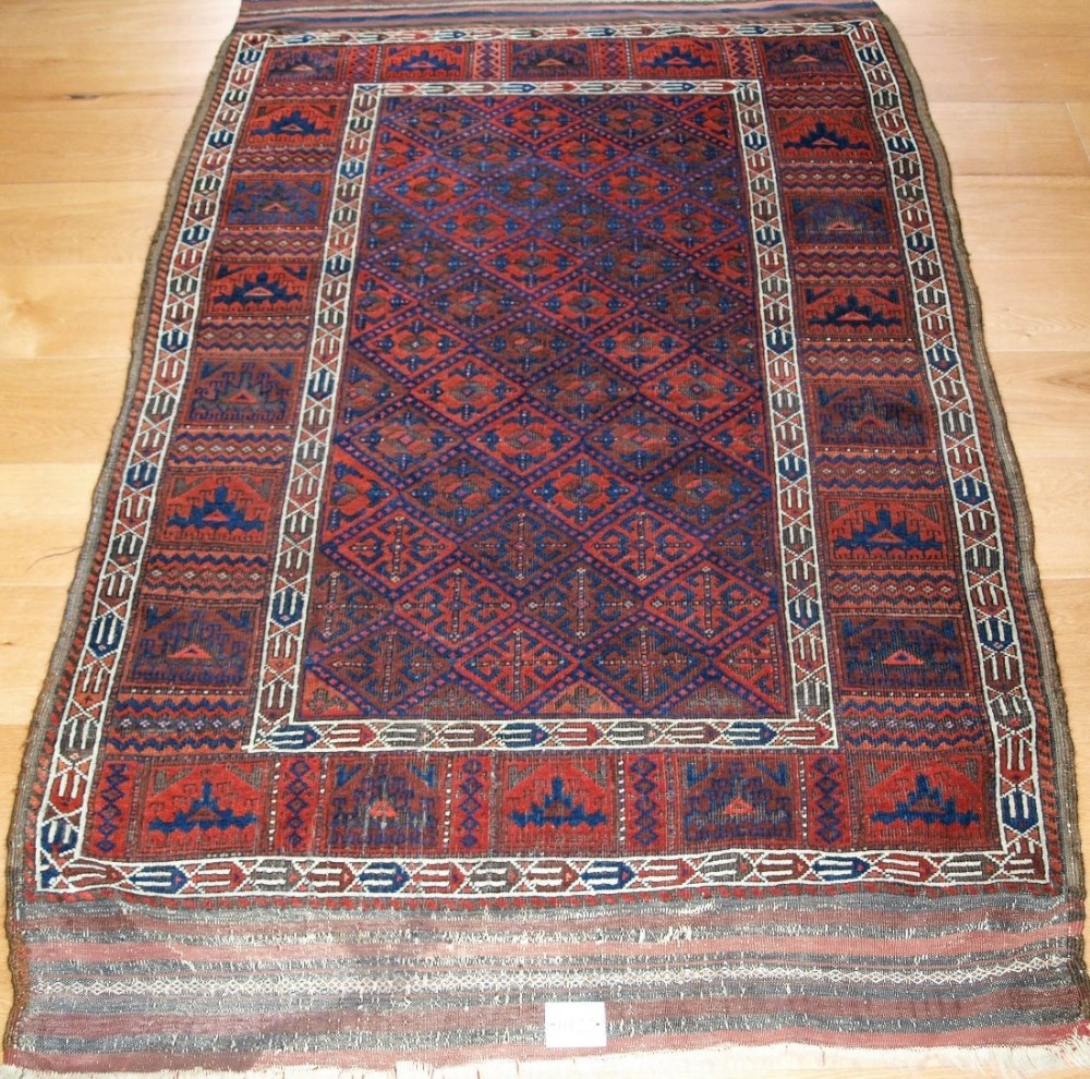 very rare antique baluch rug with calyx lattice field and yomut turkmen borders 2nd half 19th century
