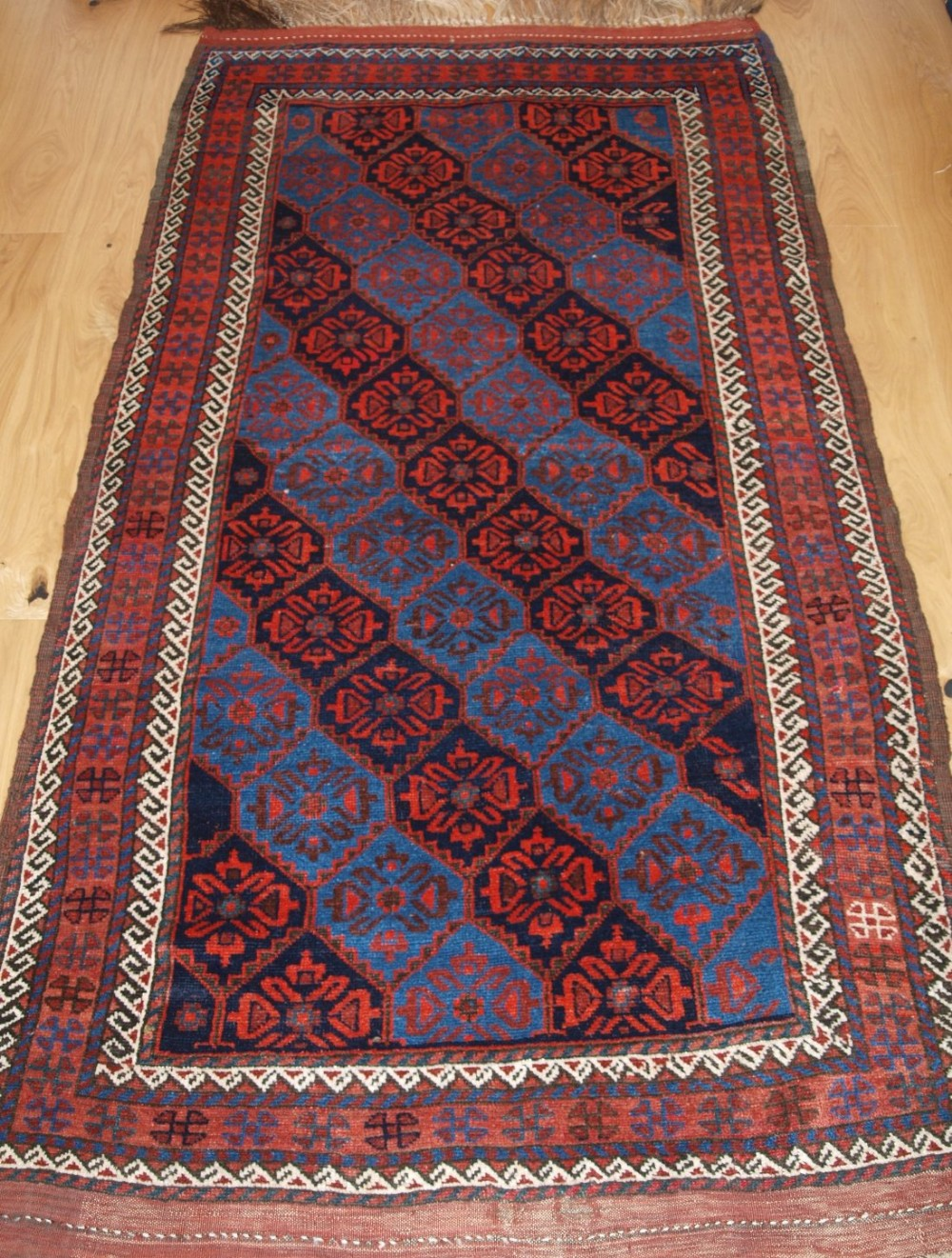 antique east persian kordi rug with lattice design and superb colour circa 1900