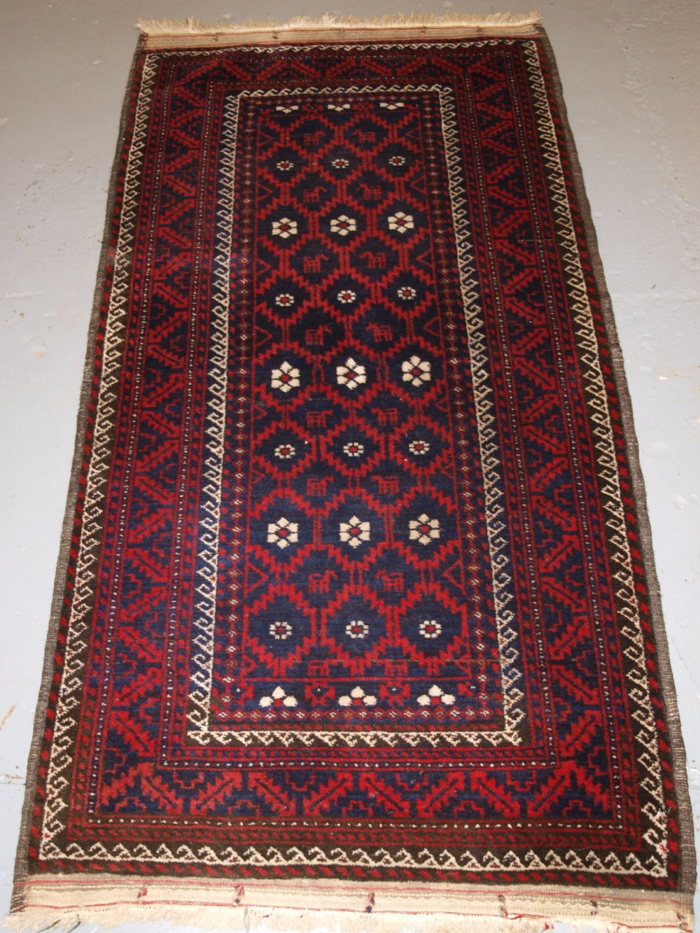 old baluch rug with lattice design flowers and animals excellent condition circa 1920