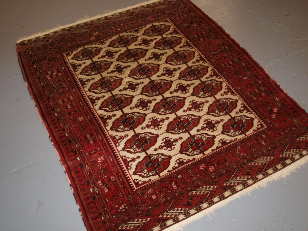 old afghan turkmen rug with tekke design on a scarce ivory ground circa 1920