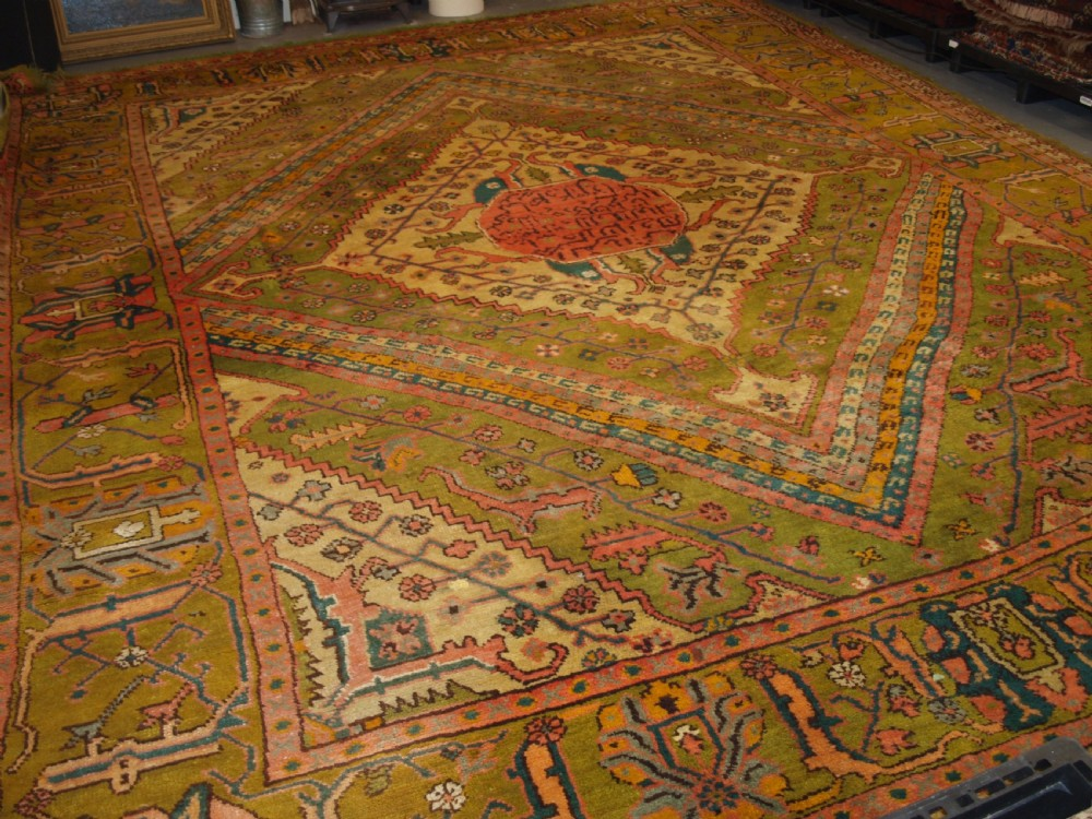 antique turkish oushak carpet unusual green field with classic persian inspired design late 19th century