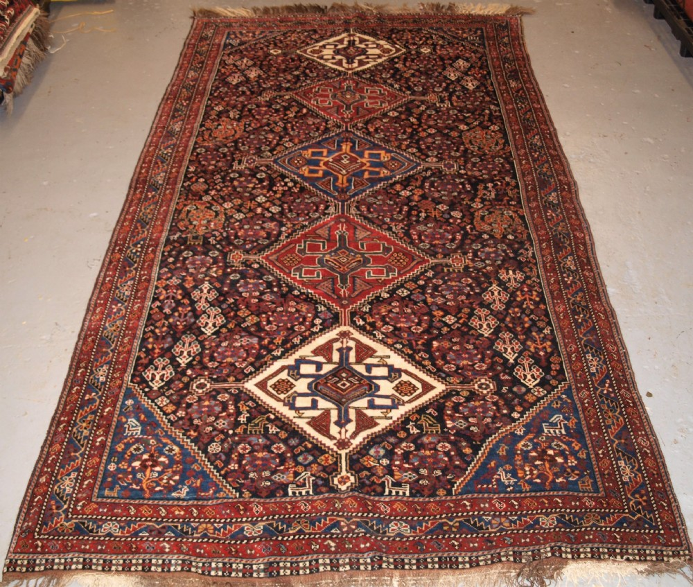 antique qashqai rug tribal design with great colour late 19th century