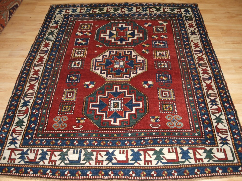antique caucasian kazak rug with memlinc guls superb border late 19th century