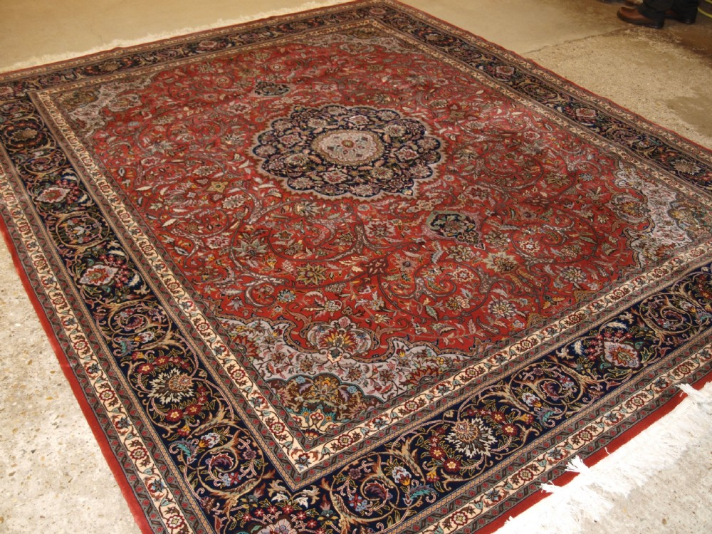 old isfahan carpet of fine weave traditional medallion design about 30 years old