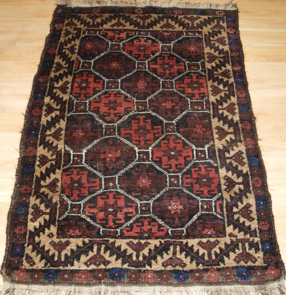 antique afghan baluch rug small size with lattice design circa 1900