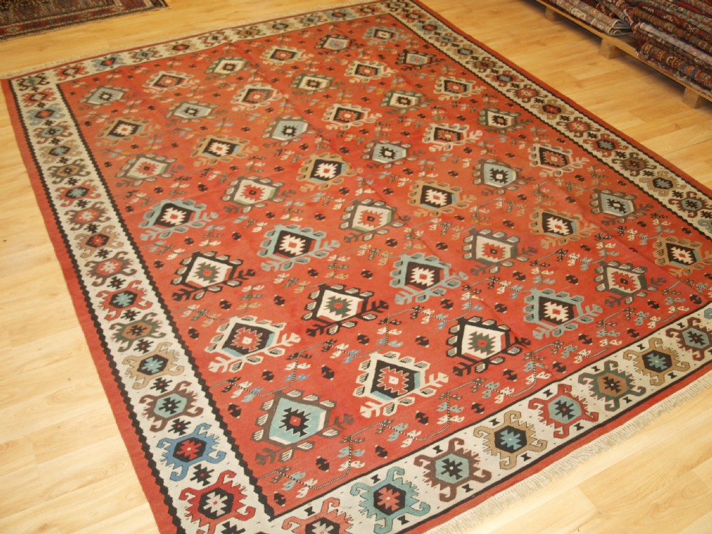 antique sharkoy kilim with large repeat design pastel colours circa 1920